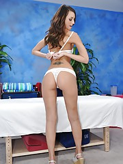This sexy 18 year old brunette gets fucked hard from behind by her massage therapist