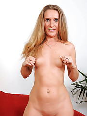 Blonde cougar wears sheer black stockings while finger fucking her mature pussy