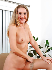 Erotic mature Sara James strips off her lingerie and fingers her shaved milf pussy