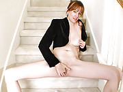 Tall natural milf plays with her pussy on the staircase