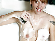 Adorable red haired housewife gets naughty in the bubble bath