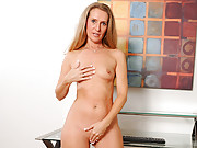 Tight bodied cougar fucks herself with a long dildo