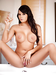 Sasha strips down to expose her long legs in white stockings and garters.