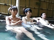 Amateur Asian cutie swims with her hot girlfriend and a stud