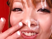 Hitomi Tanaka licks her huge breasts after they´ve been oiled up