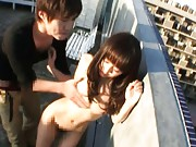 Junko Hayama naked on the rooftop and sucking a large cock