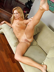 Seductive nymph Talya hangs out on her sofa then gets totally naked for an irresistible pussy show