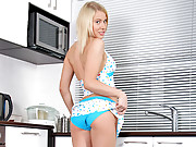 Pretty blonde nubile Catia pleasures her shaved pussy