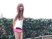 Rin Momoka flashes her pussy by lifting up her microskirt