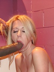 Horny young slut polishes a monster cock with her pussy