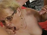Granny sucks and wanks two cocks