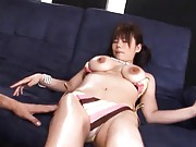 Kanon Ozora topless on the couch and getting pussy fingered