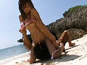 Akina lets him rub her pussy while on a public beach