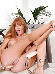Brunette Anilos Darla Crane stretches her mature pussy with a glass toy in the office
