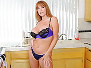Soccer mom with big tits masturbates on her kitchen counter