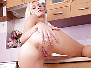 Blonde Nubile slips off her bikini and fingers herself in the kitchen