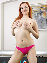 Leggy redhead princess spreads her rump to reveal her ass hole