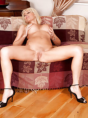 Mature blonde babe is not ashamed to reveal her shaved pussy on camera