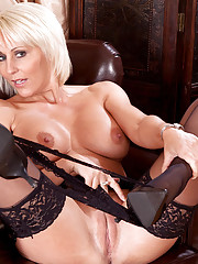 Busty pltinum blonde Anilos Jan Burton spreads her slick pussy