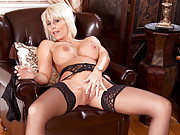 Classy blonde cougar Jan Burton massages her tits and her clit