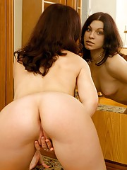 Cutie masturbates naked in front of a mirror