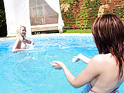 Two hot teenage lesbians kissing in the pool