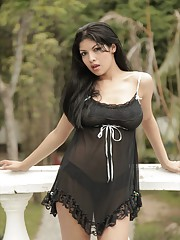 Natalia Spice wears black lingerie and gives a sexy dance before she strips nude