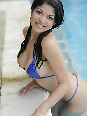 Natalia Spice slides into the pool and strips out of her tiny blue bikini