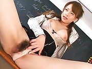 Akiho Yoshizawa spreads her legs to show a pink pussy hole