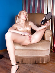 Long haired amateur tickles her pink Nubile pussy as she gets totally naked on the couch
