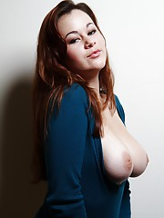 Redhead lifts up her sweater