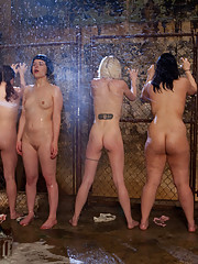 Day 1 March<br>Dirty Trainees Make Dirty Slaves-The girls are marched into the basement stripped, scrubbed, and hosed down.