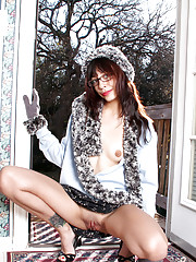 Sassy girl Pebbles loves flashing her perky Nubile assets right at the doorstep