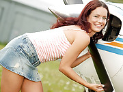 Girl masturbates near an airplane outdoors