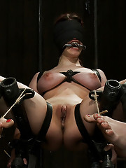 Big tits cinched tight. Relentless torment using clips, wax, canes, vibes. Iona