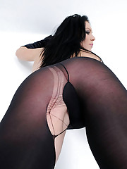 Brunette milf rips opaque pantyhose