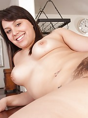 Bella Foxx mounts the kitchen bench and spreads her moist hairy lips gently with her fingers. Touching herself feels great!