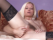 Heidi pleasures her blonde haired pussy on the bed. She takes her thick glass dildo and works it in and out of her meaty pussy until her toes curl uncontrollably.