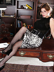 Anilos Latina Valarie slips off her office attire and spreads her pussy atop her desk