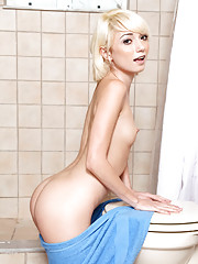 Tiny spinner Moretta Cox spreads her wet pussy in the shower at Nubiles
