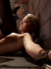 Shy sexy blond babe in thigh highs, is trapped and bound in the ultimate fuck me position.  With her long legs spread she is caned and made to cum!