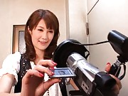 Erika Kirihara plays with a video camera to show her milf body