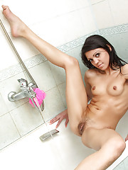 Malusha gets wet and lathers up her perky tits and fresh pussy in the shower