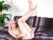 Samantha Heat spreads her long legs and stuffs a dildo in her pussy