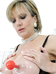 Milf pumping up her huge nipples
