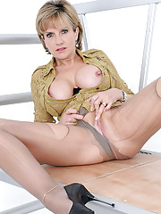 Leggy and busty mature in pantyhose