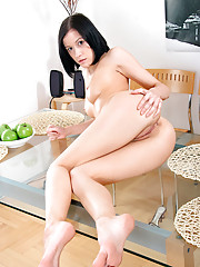 Dominika lathers oil on her nude flesh before riding a dildo