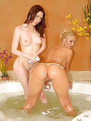 Hot megan and molly fuck each other hard in these wet bath fucking pics