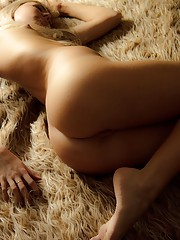 Stunning sweetheart posing naked on a carpet