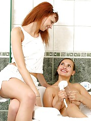 Horny lesbians sharing a hot bath and kissing
